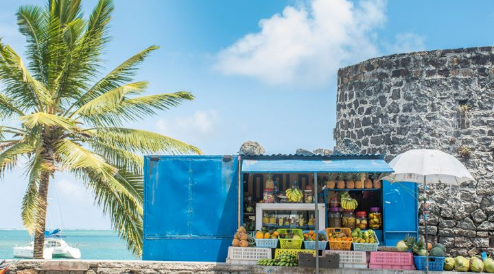 A roadside stall in Trou d' Eau Douce was one of the stops on an app-guided walk around the village. Apart from fresh fruit, there were various pickles for sale. Image credit: Melanie van Zyle